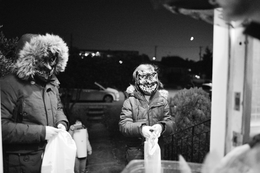 Two girls wearing masks